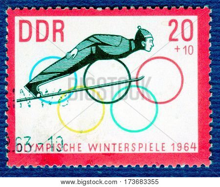 DDR - CIRCA 1964: Postage stamp printed in DDR with a picture of a Ski Jumper, with the inscription