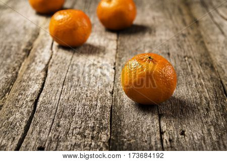 Mandarins Tangerines on a wooden background. Selective focus