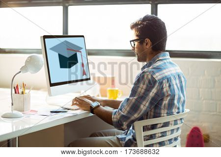 Print against business executive working on computer