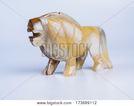 Picture of the onyx lion on white background. Side view.