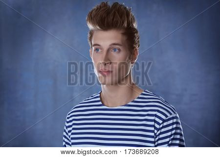 Handsome young man on color background