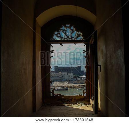 View to Baghdad and Tigris river from the broken window of Al-Mustansiriya Madrasah Iraq