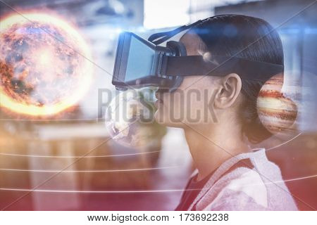Composite image of solar system against white background against businesswoman using virtual reality simulator 3D