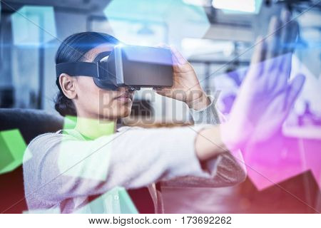 Digitally generated grey cubes floating against businesswoman using virtual reality simulator 3D