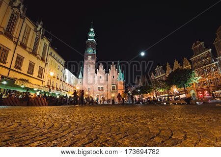 Wroclaw, Silesia, Poland - September 16, 2016. Wroclaw Market Square by night illumination. Wroclaw Old Town Hall, built in Gothic architecture style, one of the main landmarks in city.
