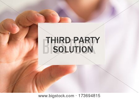 Businessman Holding A Card With Third Party Solution Message