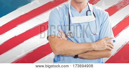 Portrait of doctor standing with arms crossed against red and white striped of american flag