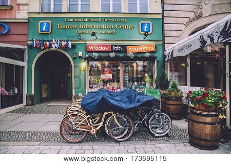 Wroclaw, Lower Silesia, Poland - September, 18th, 2016. Parked bikes near the entrance to the Tourist Information Center at Wroclaw Market Square near Old Town Hall.