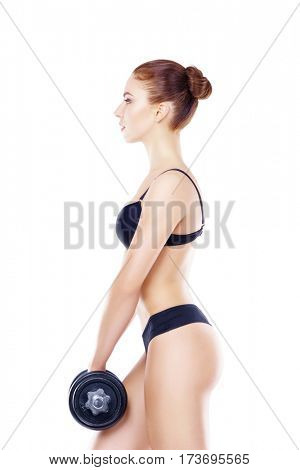 Fit, healthy and sporty woman in black swimsuit isolated on white. Beautiful girl with dumbbell. Sport, fitness, diet, weight loss and healthcare concept.