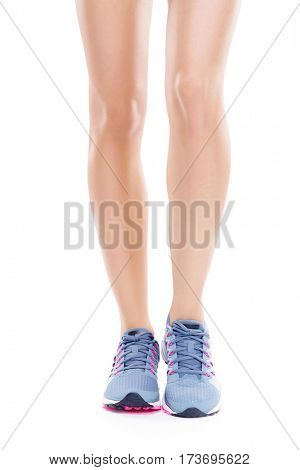 Sporty woman with a sporty legs isolated on white. Fitness, sport, diet, concept.