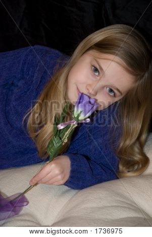 Little Girl Smelling A Rose