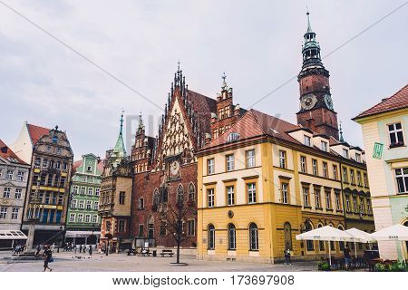 Wroclaw, Silesia, Poland - September, 17th, 2016. Market Square and Wroclaw Town Hall, built in Gothic style of architecture, is one of the main landmarks and tourist attractions in the city.