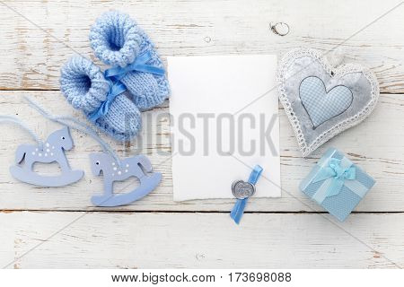 Greeting children form with blue booties and wooden horse.