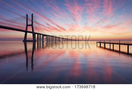 Vasco da Gama bridge in Lisbon by sunrise Portugal