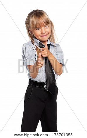 Smiling little school girl pointing finger to you, isolated on white background. Happy child pointing at camera choosing you.