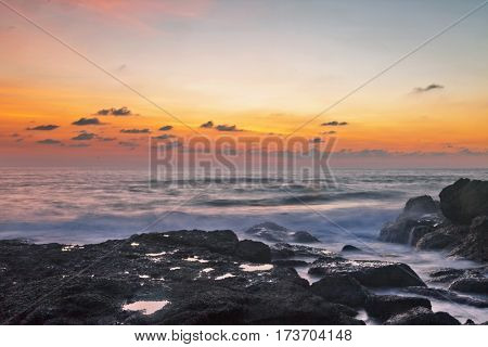 Rocks at topical beach at beautiful sunset. Nature background