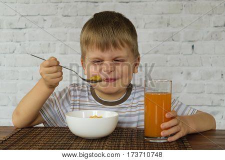 Little kid doesn't want to eat Breakfast