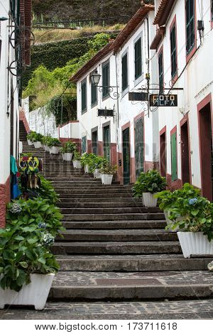 SAO VINCENTE MADEIRA PORTUGAL - SEPTEMBER 5 2016: Steep stairs decorated with flowers in Sao Vincente. Madeira. Portugal