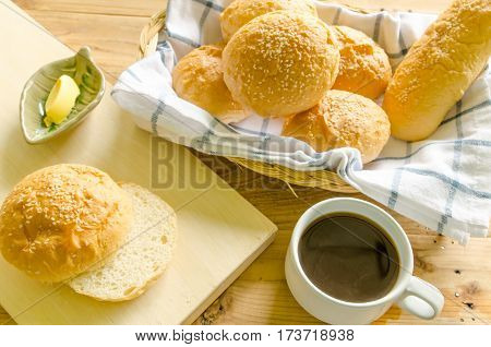 A delicious breakfast with coffee bread butter.
