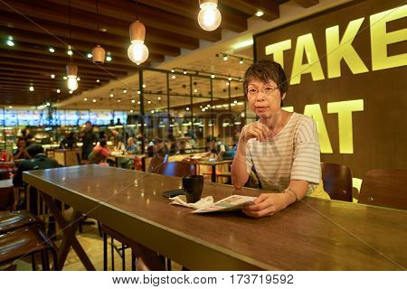 HONG KONG - CIRCA NOVEMBER, 2016: indoor portrait of a woman at Maxim's MX2 restaurant. Maxim's Caterers Limited is Hong Kong's largest food & beverage corporation and restaurant chain.