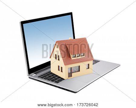 House on laptop isolated on white