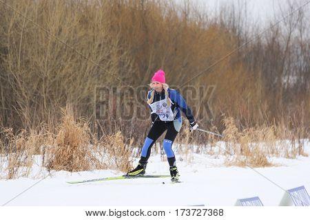 Kirishi, Russia - 11 February, Girl on the ski run, 11 February, 2017. Mass ski race Russian Ski Track.
