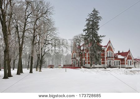 Ancient homestead in Art Nouveau style in the village Golovichpole in the winter, Grodno region, Belarus.