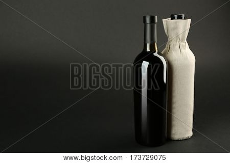 St. Valentine's Day concept. Wine bottles on dark background