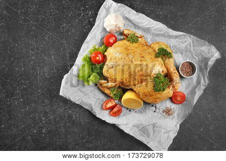 Marinaded chicken with garnish on parchment