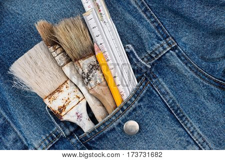 Brushes pencil in the pocket of denim triggers. Top view.