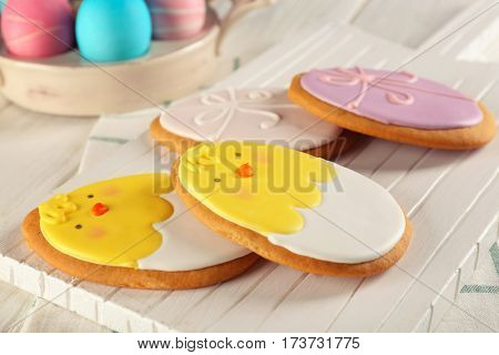 Creative Easter sugar cookies on white wooden board