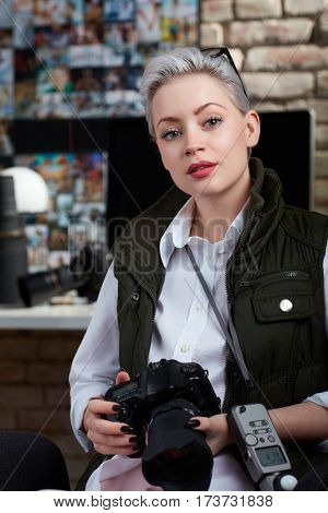 Portrait of attractive young female photographer.