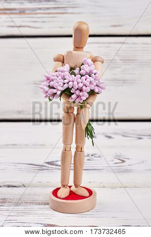 Manikin holding bunch of flowers. Thank you for everything.
