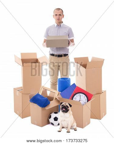 Moving Day Concept - Handsome Man With Brown Cardboard Boxes And Dog Isolated On White