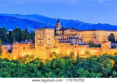 Granada, Spain. Alhambra fortress illuminated at twilight.