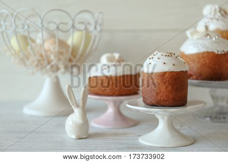 Easter cake on stand on wooden table