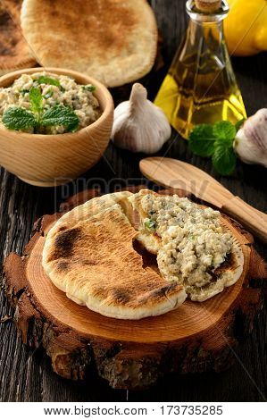 Traditional greek eggplant spread (dip) with pita bread.