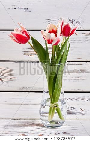Glass vase with spring flowers. How to beautify your house.