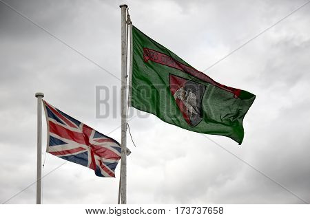 WEEDON, UK - AUGUST 28: The Union Jack and the Buckinghamshire county flag fly high above the main show arena at the Bucks County show on August 28, 2014 in Weedon