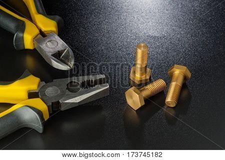 Pliers With Brass Screws On Dark With Stole.komponenty Equipment.