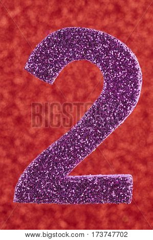 Number two purple color over a red background. Anniversary. Vertical