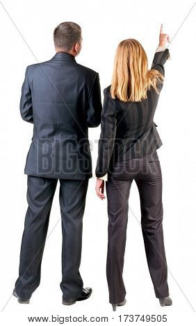 Back view of  pointing business team. young couple (man and woman) .  beautiful friendly girl and guy in suit together. Rear view people collection.  backside view of person.