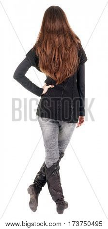 back view of standing young beautiful woman. blonde girl in jeans and sweater watching . Rear view people collection. backside view of person. Isolated over white background.