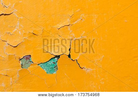 Texture background of bright yellow and blue texture peeling paint - texture wall with chipped paint on the texture surface. Texture background
