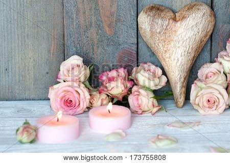 Still life with a heart and roses for mothers day in country house style