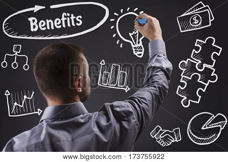 Technology, Internet, Business And Marketing. Young Business Man Writing Word: Benefits
