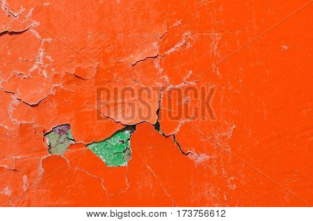 Texture background of orange and green texture peeling paint -closeup of texture peeling paint on the rough texture stone surface. Texture background with peeling orange paint