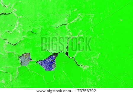 Texture peeling paint of green and purple colors on the stone texture background. Texture stone surface with peeling texture colorful paint - texture background