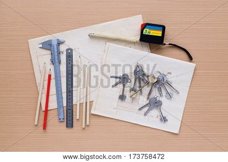 Set Of Measuring Tools On Wooden Background