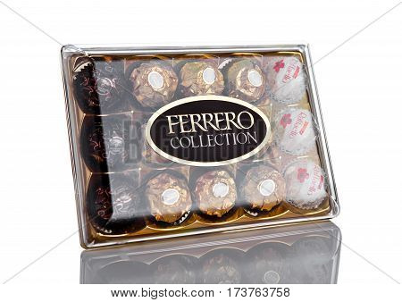 LONDON UK - FEBRUARY 28 Ferrero Collection Rocher premium chocolate sweets plastic box.On white background with reflection.